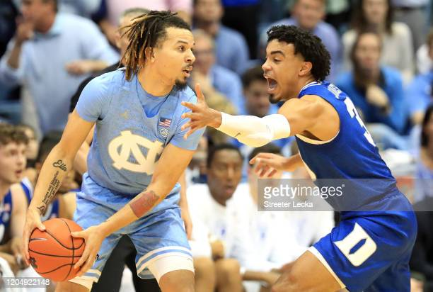 Tre Jones of the Duke Blue Devils tries to stop Cole Anthony of the North Carolina Tar Heels during their game at Dean Smith Center on February 08,...