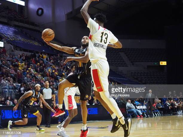 Tre Kelley of the Fort Wayne Mad Ants shoots the ball against Kavell BigbyWilliams of the Erie Bayhawks on December 13 2019 at Memorial Coliseum in...