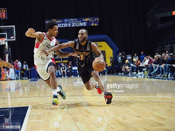 Tre Kelley the Fort Wayne Mad Ants handles the ball against Jalen Adams of the Erie Bayhawks on December 13 2019 at Memorial Coliseum in Fort Wayne...