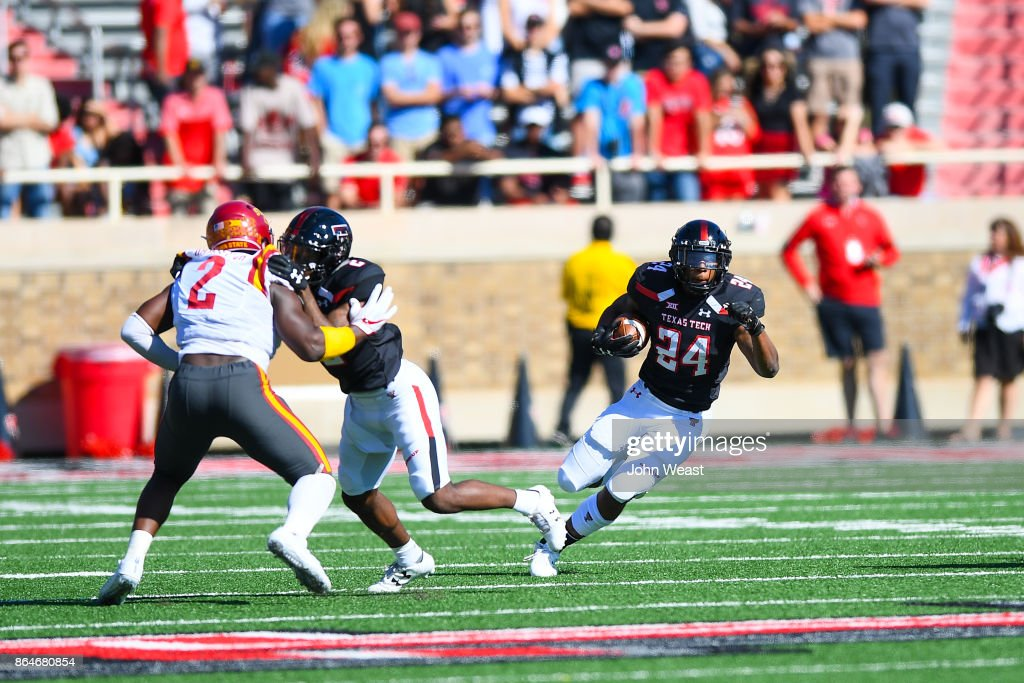 Tre King #24 of the Texas Tech Red Raiders gets some running room during the game against the Iowa State Cyclones on October 21, 2017 at Jones AT&T Stadium in Lubbock, Texas.