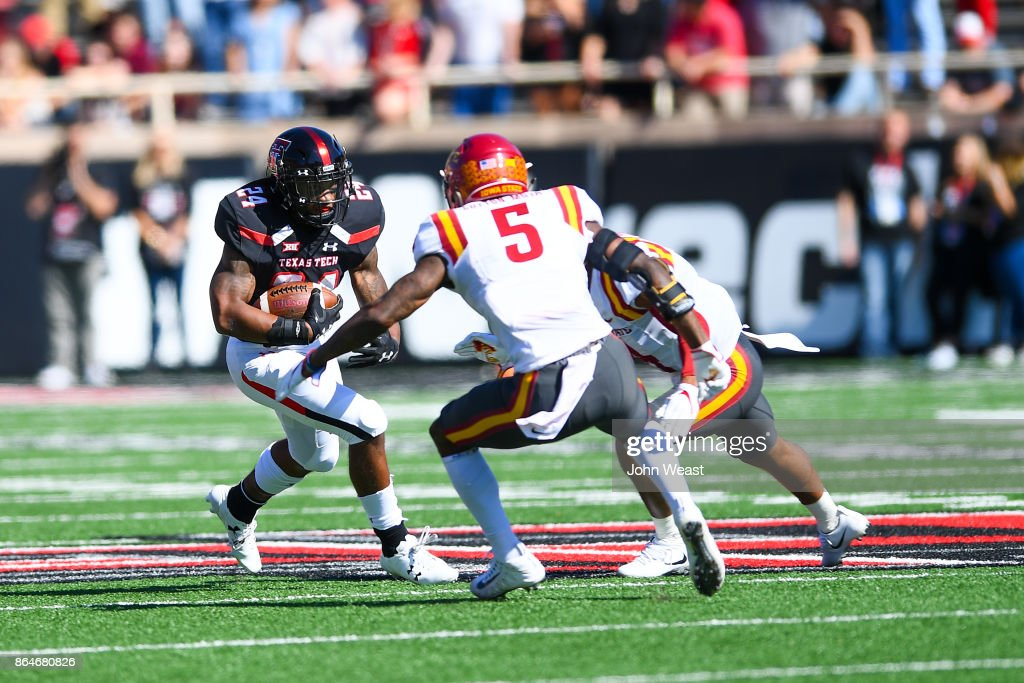 Tre King #24 of the Texas Tech Red Raiders looks for running room during the game against the Iowa State Cyclones on October 21, 2017 at Jones AT&T Stadium in Lubbock, Texas.