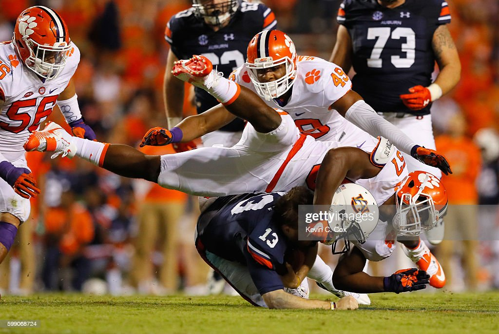 Tre Lamar #57 of the Clemson Tigers tackles Sean White #13 of the Auburn Tigers during the second half at Jordan Hare Stadium on September 3, 2016 in Auburn, Alabama.