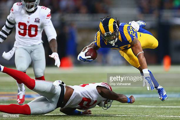 Tre Mason Of The St Louis Rams Is Tackled By Antrel Rolle New York