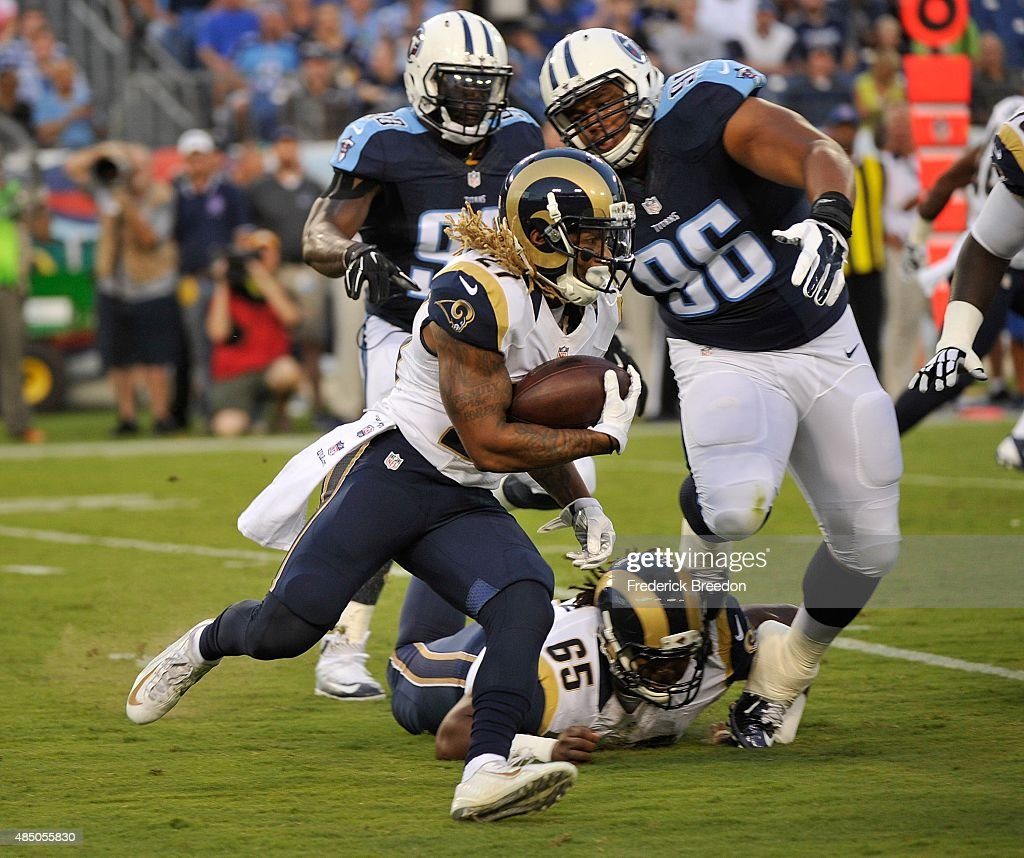 Tre Mason #23 of the St. Louis Rams rushes during a pre-season game against the Tennessee Titans at LP Field on August 23, 2015 in Nashville, Tennessee.