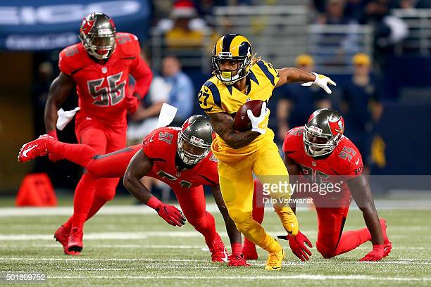 Tre Mason of the St Louis Rams rushes in the first quarter against the Tampa Bay Buccaneers at the Edward Jones Dome on December 17 2015 in St Louis...
