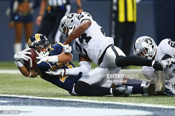 Tre Mason of the St Louis Rams scores a touchdown against the Oakland Raiders in the third quarter at the Edward Jones Dome on November 30 2014 in St...