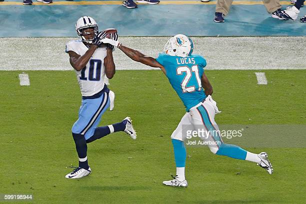 Tre McBride of the Tennessee Titans catches the ball while being defended by Jordan Lucas of the Miami Dolphins during a preseason game on September...