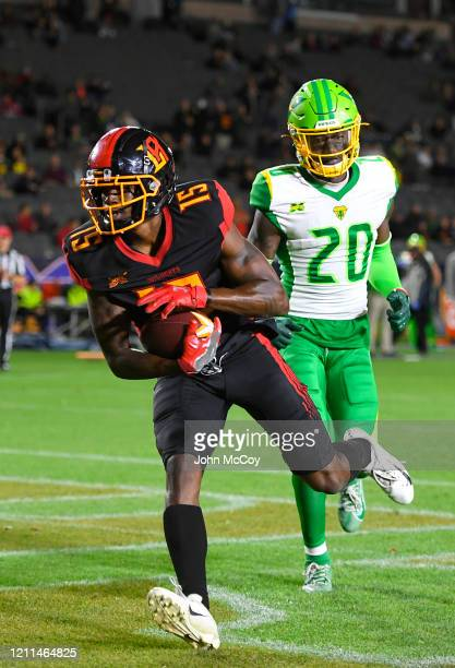 Tre McBride of the LA Wildcats catches a touchdown pass against Bryce Canady of the Tampa Bay Vipers at Dignity Health Sports Park during an XFL game...