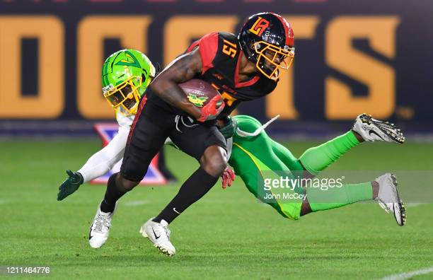 Tre McBride of the LA Wildcats gets past safety Robenson Therezie of the Tampa Bay Vipers at Dignity Health Sports Park during an XFL game on March 8...