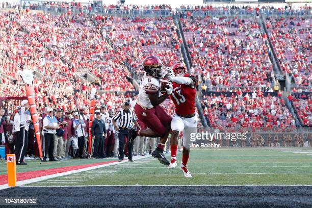 Tre' McKitty of the Florida State Seminoles makes a 25-yard touchdown reception against P.J. Blue of the Louisville Cardinals in the fourth quarter...