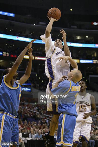 Tre Morrison of the Washington Huskies shoots over Brian Morrison of the UCLA Bruins during the quarterfinals of the 2004 Pacific Life Pac10...