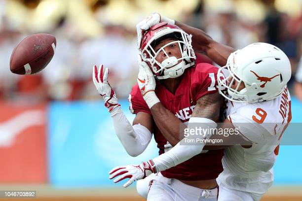 Tre Norwood of the Oklahoma Sooners is called for pass interference on a pass intended for Collin Johnson of the Texas Longhorns in the fourth...