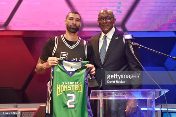 Tre Simmons poses with BIG3 Commissioner Clyde Drexler after being drafted at by the 3 Headed Monsters in the second round during the BIG3 Draft at...