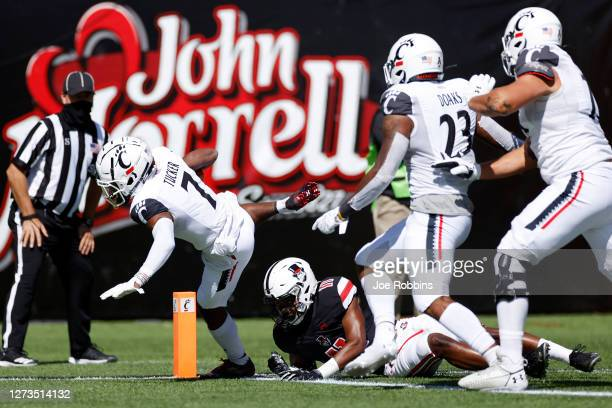 Tre Tucker of the Cincinnati Bearcats runs into the end zone for a 29-yard touchdown after making a reception in the first quarter of the game...