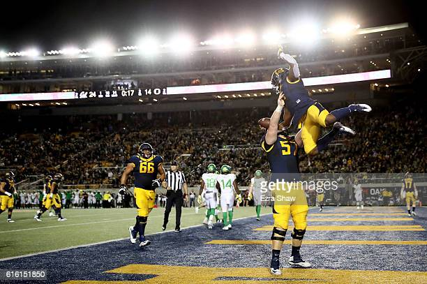Tre Watson of the California Golden Bears is lifted up by Addison Ooms after he caught a touchdown pass against the Oregon Ducks at California...