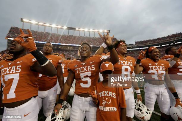 Tre Watson of the Texas Longhorns celebrates with teammates after the game against the TCU Horned Frogs at Darrell K RoyalTexas Memorial Stadium on...