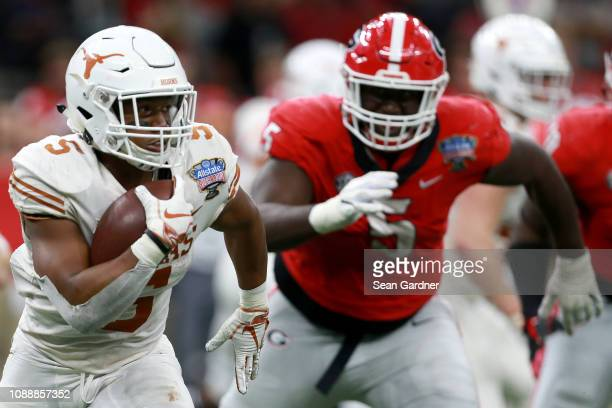 Tre Watson of the Texas Longhorns runs the ball against the Georgia Bulldogs during the second half of the Allstate Sugar Bowl at the MercedesBenz...