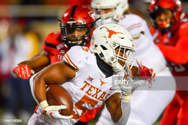 Tre Watson of the Texas Longhorns tries to run by Jordyn Brooks of the Texas Tech Red Raiders during the game on November 10 2018 at Jones ATT...