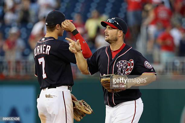 Trea Turner and Chris Heisey of the Washington Nationals celebrate after defeating the Atlanta Braves 64 at Nationals Park on September 5 2016 in...