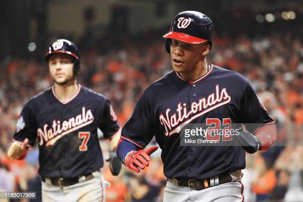 Trea Turner and Juan Soto of the Washington Nationals score runs on a single by Asdrubal Cabrera against the Houston Astros during the seventh inning...