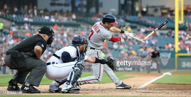Trea Turner of the Washington Nationals breaks his bat during the fifth inning of the game against the Detroit Tigers at Comerica Park on June 28...