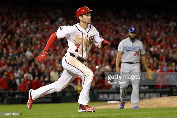Trea Turner of the Washington Nationals cannot make it to first base and is forced out for the the first out of the ninth inning against the Los...