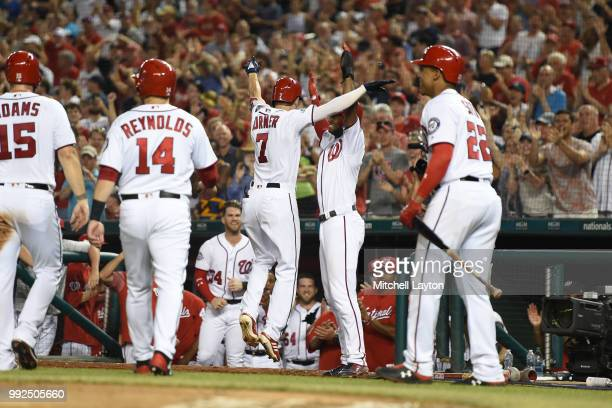 Trea Turner of the Washington Nationals celebrates a grand slam in the sixth inning with teammates during a baseball game against the Miami Marlins...