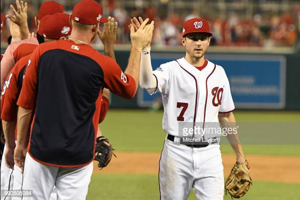 Trea Turner of the Washington Nationals celebrates a win with teammates against the Miami Marlins at Nationals Park on July 5 2018 in Washington DC