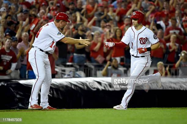 Trea Turner of the Washington Nationals celebrates after hitting a two run home run against Brandon Woodruff of the Milwaukee Brewers during the...