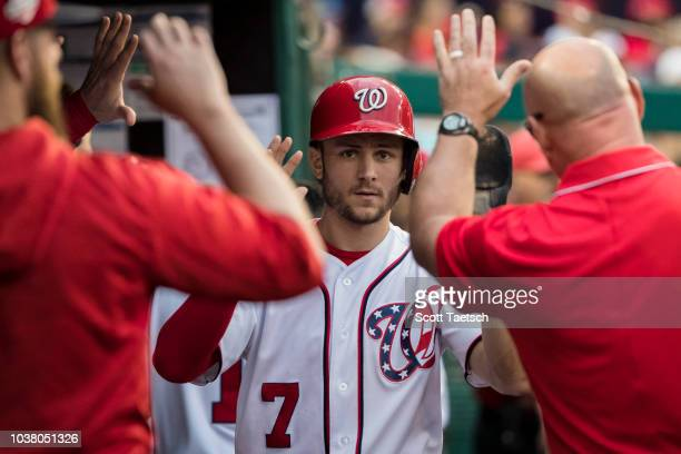 Trea Turner of the Washington Nationals celebrates after scoring against the New York Mets during the seventh inning at Nationals Park on September...
