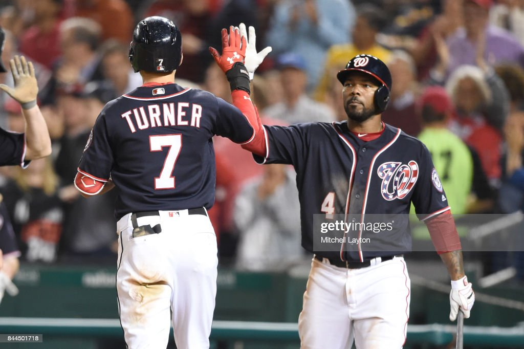 Trea Turner #7 of the Washington Nationals celebrates hitting a two run home run in the sixth inning with Howie Kendrick #4 during a baseball game against the Philadelphia Phillies at Nationals Park on September 8, 2017 in Washington, DC.