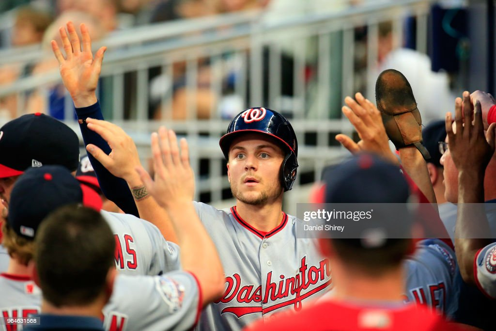 Trea Turner #7 of the Washington Nationals celebrates scoring during the third inning against the Atlanta Braves at SunTrust Park on May 31, 2018 in Atlanta, Georgia.