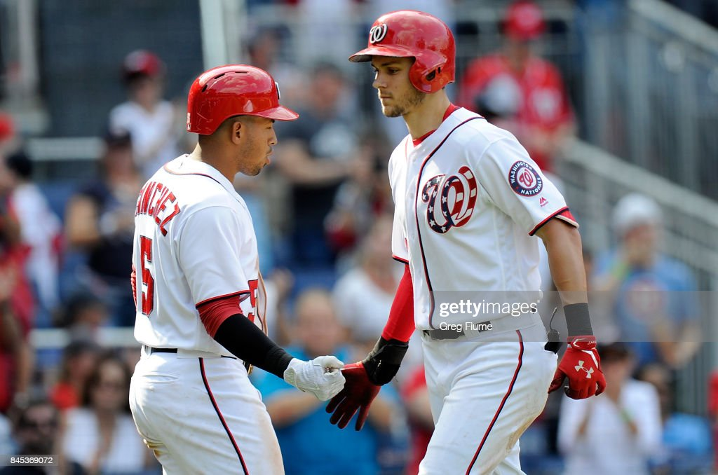 Trea Turner #7 of the Washington Nationals celebrates with Adrian Sanchez #5 after hitting a home run in the eighth inning against the Philadelphia Phillies at Nationals Park on September 10, 2017 in Washington, DC.