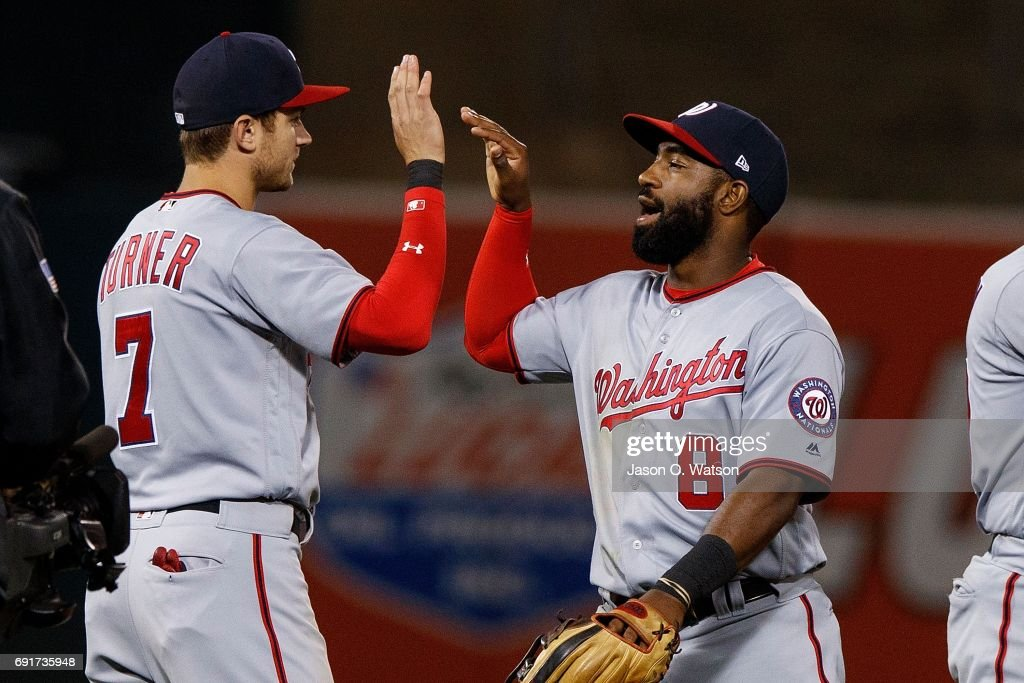 Trea Turner #7 of the Washington Nationals celebrates with Brian Goodwin #8 after the game against the Oakland Athletics at the Oakland Coliseum on June 2, 2017 in Oakland, California. The Washington Nationals defeated the Oakland Athletics 13-3.