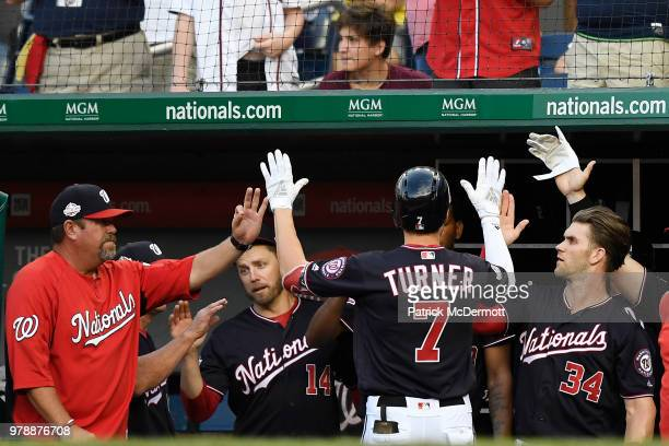 Trea Turner of the Washington Nationals celebrates with his teammates after hitting a solo home run in the second inning against the Baltimore...