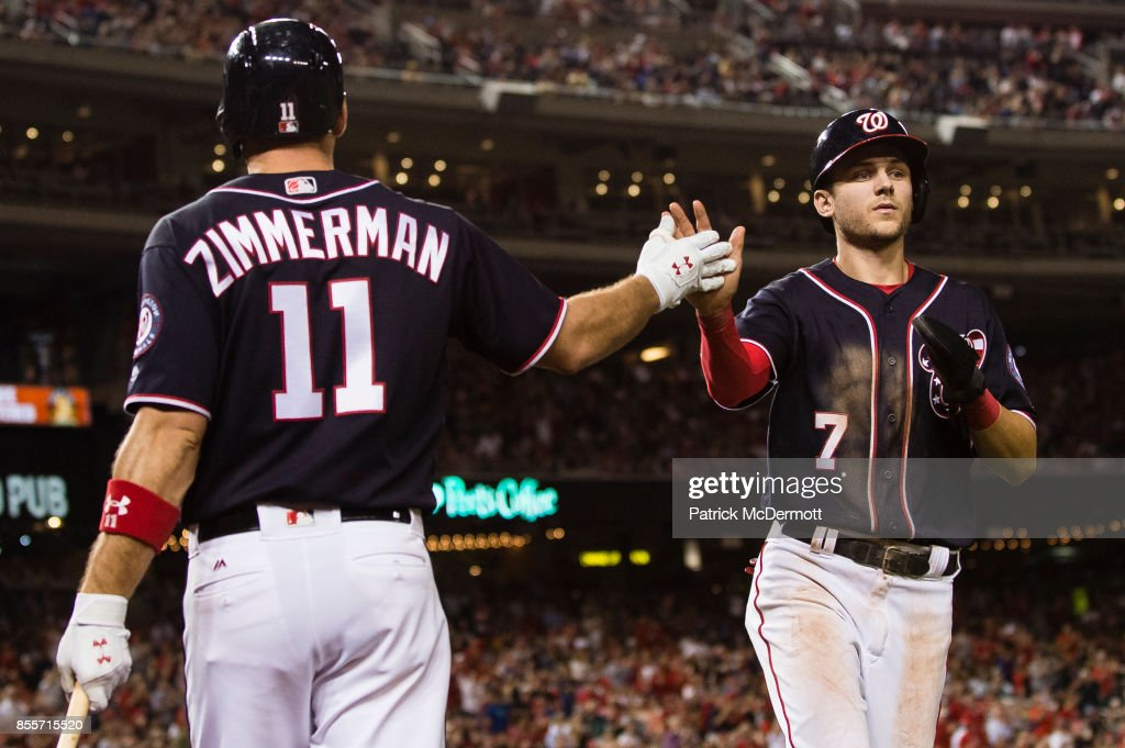 Trea Turner #7 of the Washington Nationals celebrates with Ryan Zimmerman #11 after scoring on a single hit by Daniel Murphy #20 (not pictured) in the sixth inning against the Pittsburgh Pirates at Nationals Park on September 29, 2017 in Washington, DC.