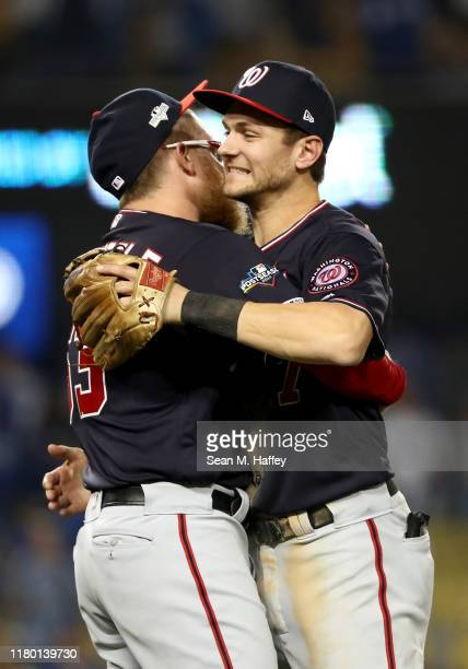 Trea Turner of the Washington Nationals celebrates with Sean Doolittle after the Nationals defeated the Los Angeles Dodgers 73 in game five to win...