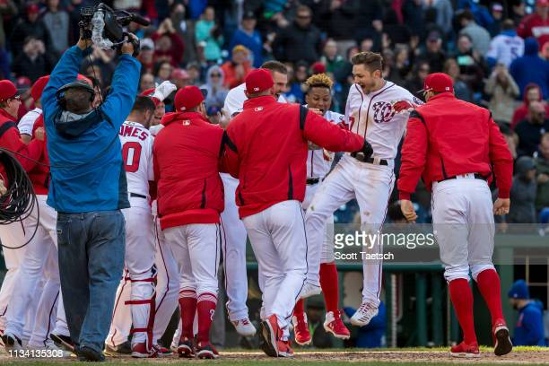 Trea Turner of the Washington Nationals celerbrates with teammates after hitting a walkoff home run to win the game against the New York Mets during...
