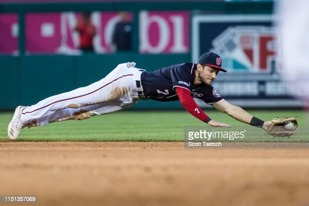 Trea Turner of the Washington Nationals dives for a ground ball against the Atlanta Braves during the fifth inning at Nationals Park on June 21 2019...