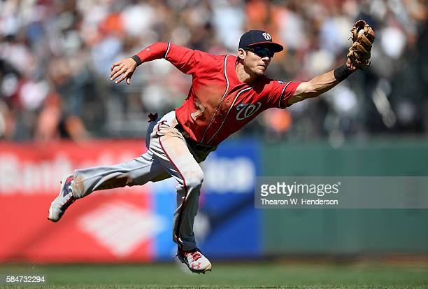 Trea Turner of the Washington Nationals dives to take a hit a way from Conor Gillaspie of the San Francisco Giants in the bottom of the seventh...