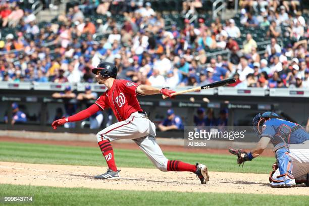 Trea Turner of the Washington Nationals drives in a run with a single against the New York Mets in the seventh inning during their game at Citi Field...