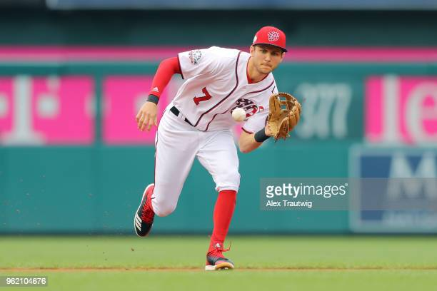 Trea Turner of the Washington Nationals fields a ball during a game against the San Diego Padres at Nationals Park on Wednesday May 23 2018 in...
