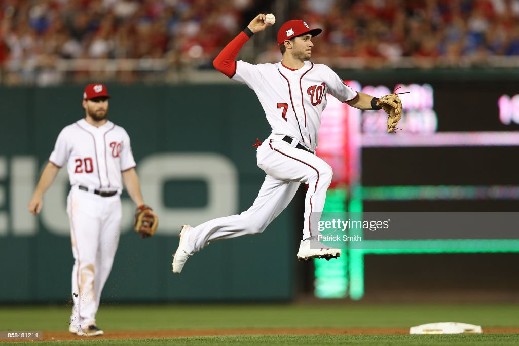Trea Turner #7 of the Washington Nationals fields a ground ball against the Chicago Cubs in the 6th inning during game one of the National League Division Series at Nationals Park on October 6, 2017 in Washington, DC.