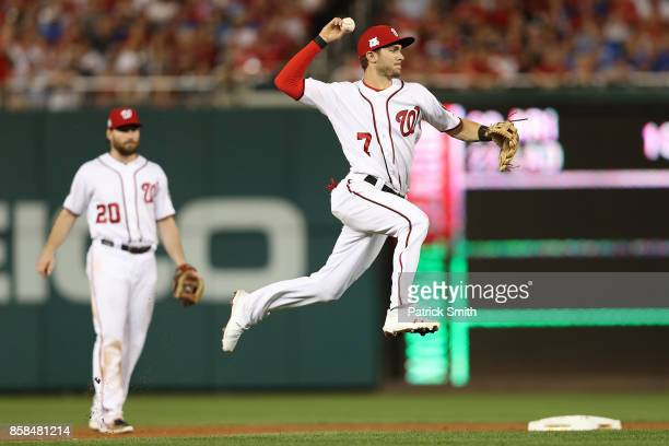 Trea Turner of the Washington Nationals fields a ground ball against the Chicago Cubs in the 6th inning during game one of the National League...