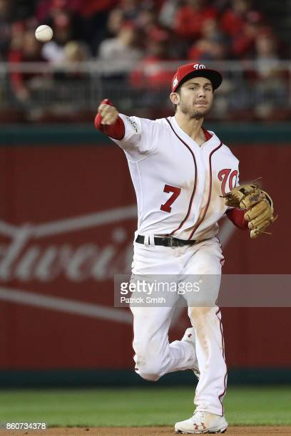 Trea Turner of the Washington Nationals fields a ground ball against the Chicago Cubs during the fifth inning in game five of the National League...