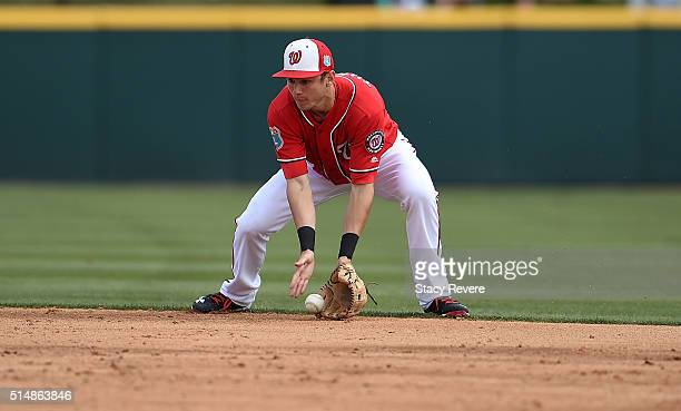 Trea Turner of the Washington Nationals fields a ground ball during the fourth inning of a spring training game against the New York Mets at Space...