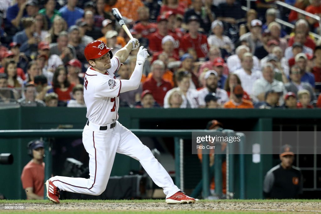 Trea Turner #7 of the Washington Nationals follows his eighth inning hit against the Baltimore Orioles at Nationals Park on June 21, 2018 in Washington, DC.