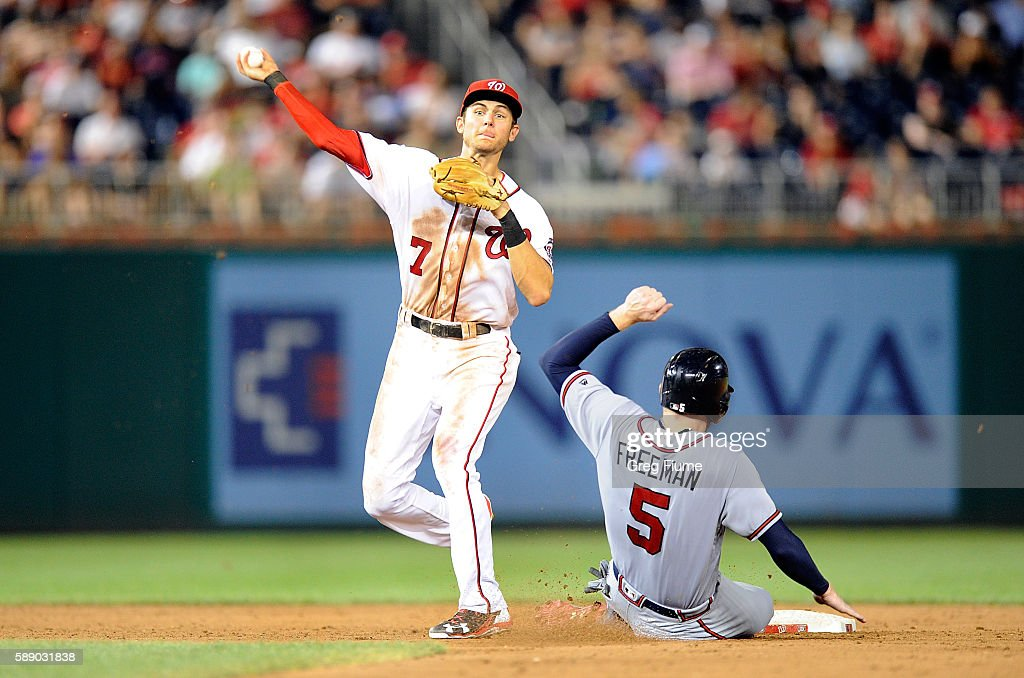 Trea Turner #7 of the Washington Nationals forces out Freddie Freeman #5 of the Atlanta Braves to start a double play in the ninth inning at Nationals Park on August 12, 2016 in Washington, DC. Atlanta won the game 8-5.