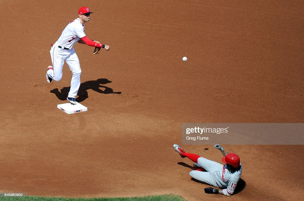 Trea Turner #7 of the Washington Nationals forces out Freddy Galvis #13 of the Philadelphia Phillies to start a double play in the fourth inning at Nationals Park on September 10, 2017 in Washington, DC.