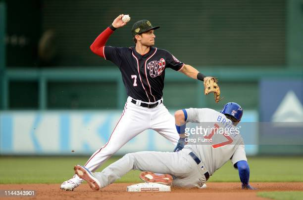 Trea Turner of the Washington Nationals forces out Kris Bryant of the Chicago Cubs to start a double play in the first inning at Nationals Park on...